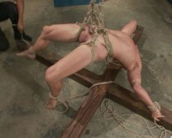 Blonde hunk gay dude hanging high in a bondage sex