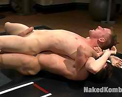 Male fights and fucks guy in a sweaty wrestling mat
