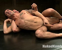 Male gets in a hot naked wrestling session fucked by his trainer