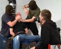 Sinful master in mask  tied a kidnapped guy then makes him a sex slave