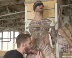 Tattooed guy tied up in a post and got swarmed by brutal guys
