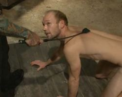 Two  older gay men play in the sex den