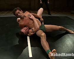 Two ripped studs fight naked in oil and the winner fucks the loser.